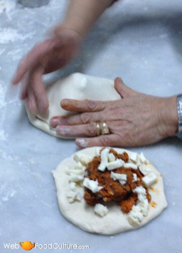 Filling the 'calzone'.