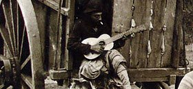 Argentinian Asado: Argentine gaucho playing guitar (img-01)