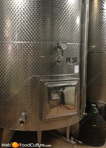 Champagne wine: Fermentation tank and temperature gauge.