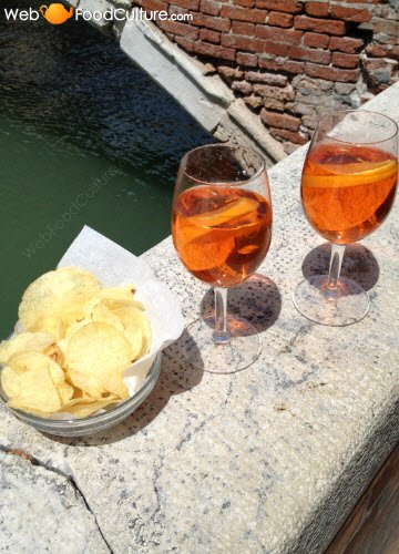 Drinking Aperol Spritz in the 'calli' of Venice.